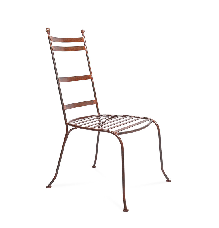 Valerie Chair - hand shaped Moroccan wrought iron dining chair, perfectly suited to indoor or outdoor use. Side view.