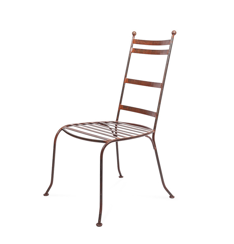 Valerie Chair - hand shaped Moroccan wrought iron dining chair, perfectly suited to indoor or outdoor use. Three quarter view.