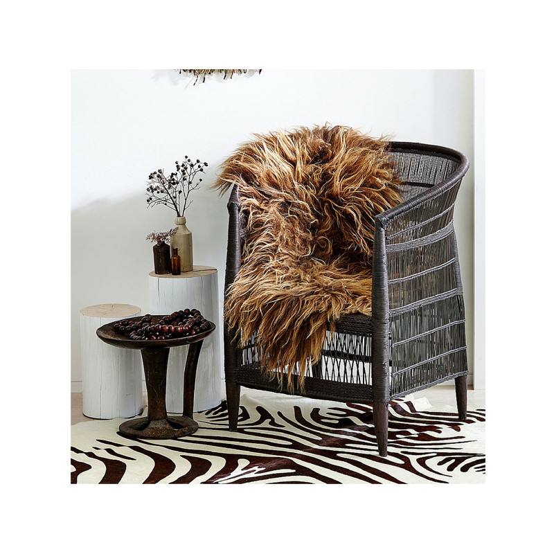Icelandic Sheepskin Copper Caramel. Add warmth, texture and luxury to your space with this naturally silky soft long haired Icelandic Merino sheepskin throw rug in copper caramel. Styled view.