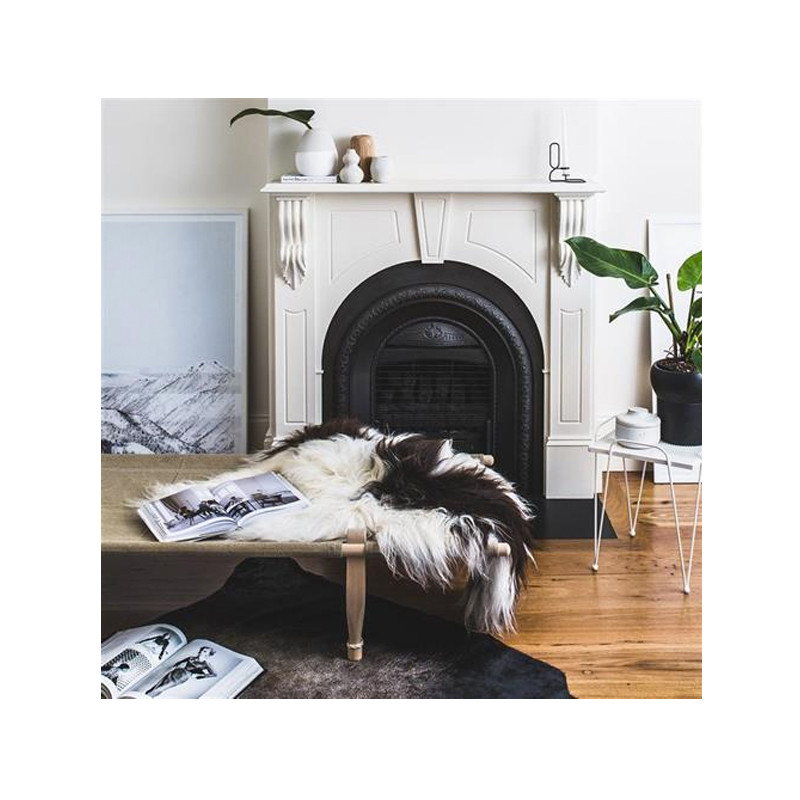 Icelandic Sheepskin Brown Spot. Add warmth, texture and luxury to your space with this naturally silky soft long haired Icelandic Merino sheepskin throw rug brown spot. Styled view.