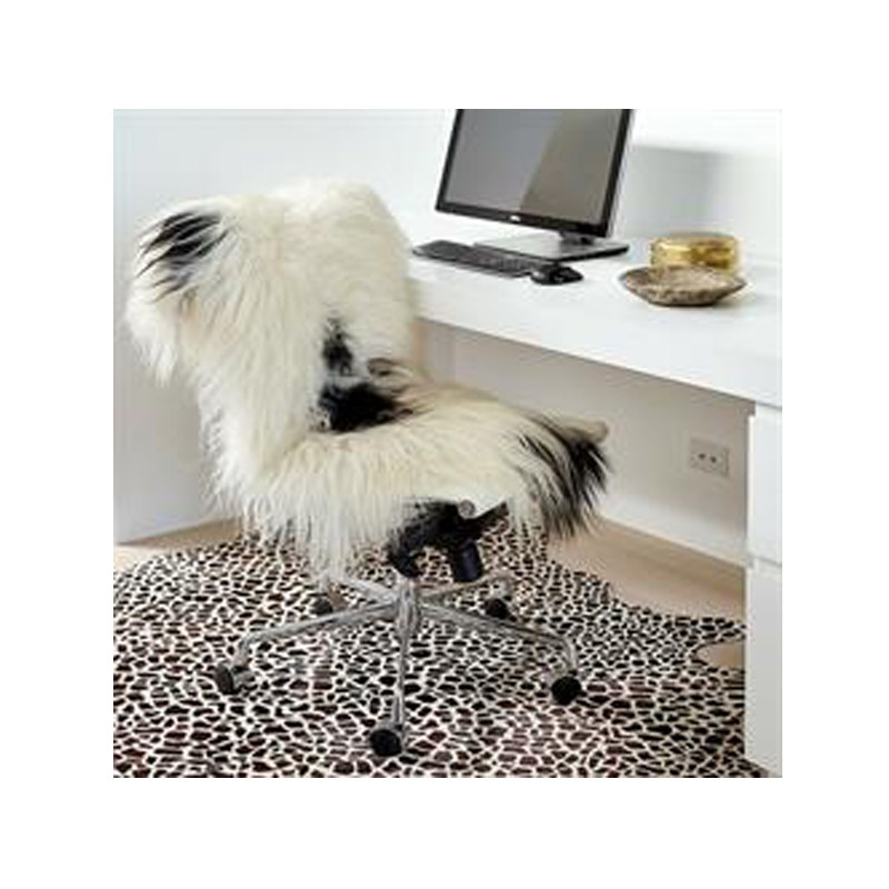 Icelandic Sheepskin White with Black Spot. Add warmth, texture and luxury to your space with this naturally silky soft long haired Icelandic Merino sheepskin throw rug in white with black spot. Styled view.