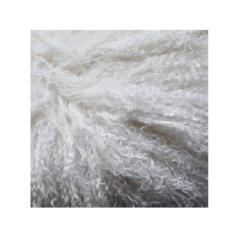 Mongolian Sheepskin Throw White. Add warmth, texture and luxury to your space with this naturally silky soft sheepskin throw rug in white. Detail view.