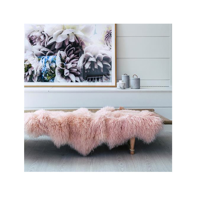 Mongolian Sheepskin Throw Rug Blush Pink. Add warmth, texture and luxury to your space with this naturally silky soft sheepskin throw rug in delicate blush pink. Styled view.