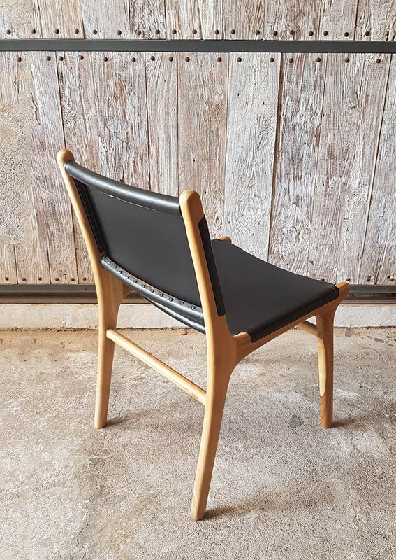Teak dining chair with high quality black leather seat and back support. Back view
