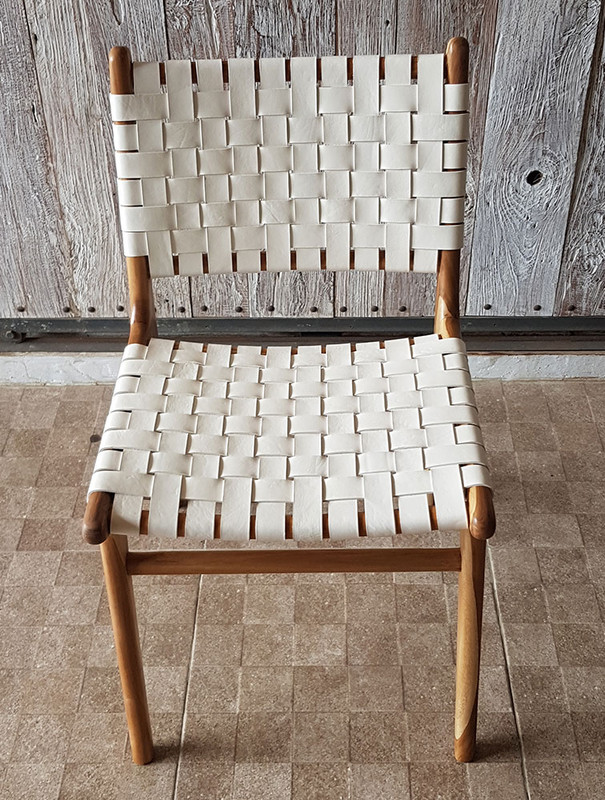 This high quality teak dining chair offers quality and comfort with woven leather to allow the perfect balance of give and support. Front view 2