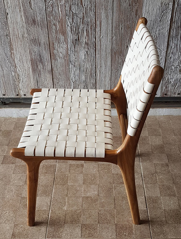 This high quality teak dining chair offers quality and comfort with woven leather to allow the perfect balance of give and support. Side view