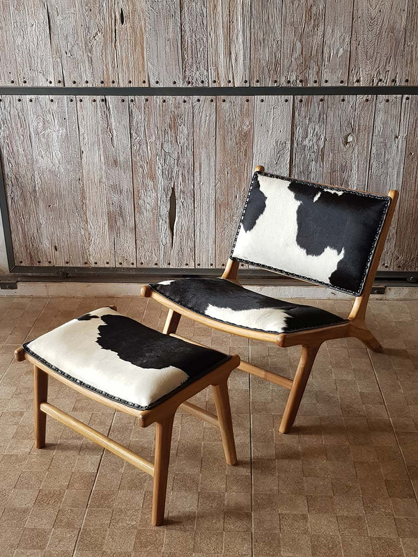 This gorgeous teak and genuine, high quality cowhide chair is designed for deep relaxation looks great in a rustic farmhouse, industrial-style setting or minimal Modernist room.