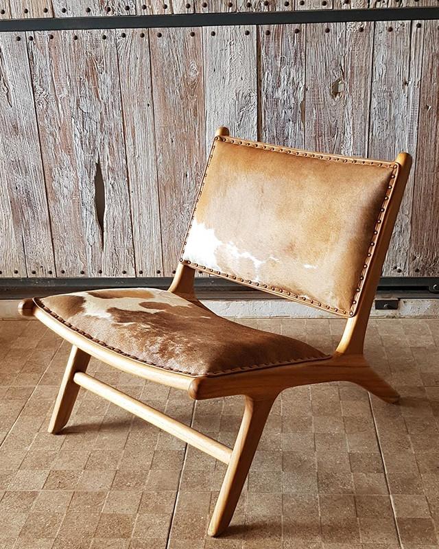 This gorgeous teak and genuine cowhide chair is designed for deep relaxation. Looks great in rustic farmhouse, industrial settings and mid-century modern spaces alike.