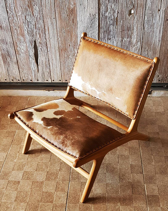 This gorgeous teak and genuine cowhide chair has comfort on its mind.