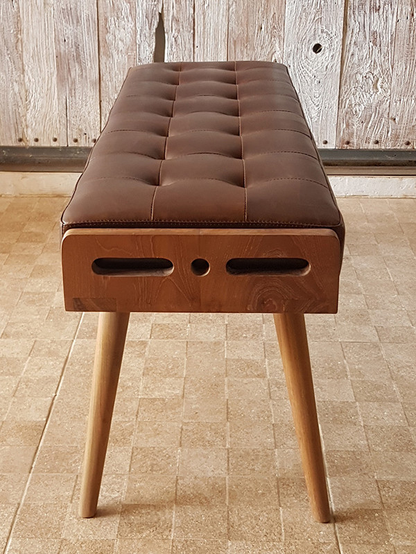 Luxurious and plush buttoned leather bench seat with solid teak frame. Side view
