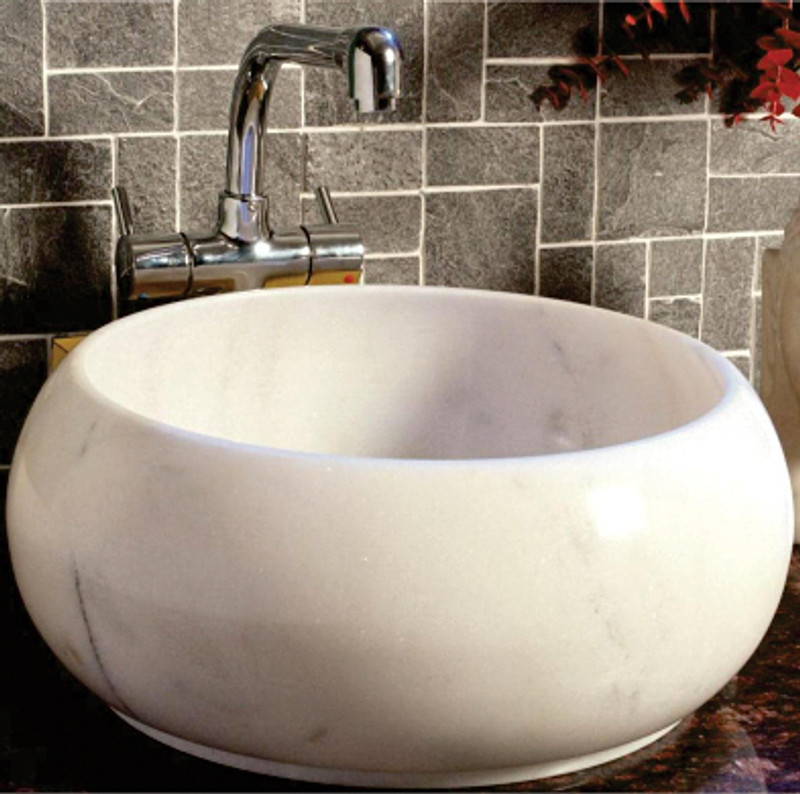 The beautiful Sunflower hand basin is crafted from solid white marble and ties in nicely with a range of decor styles, from classical to contemporary.
