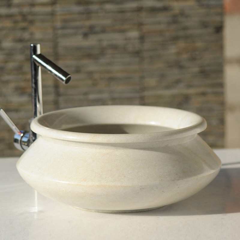 This elegant hand basin's unique shape incites thoughts of Aladdin's Cave and other exotic lands.