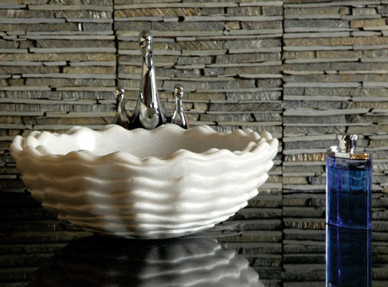 The Oceansong white marble hand basin brings echoes of the sea to your bathroom.