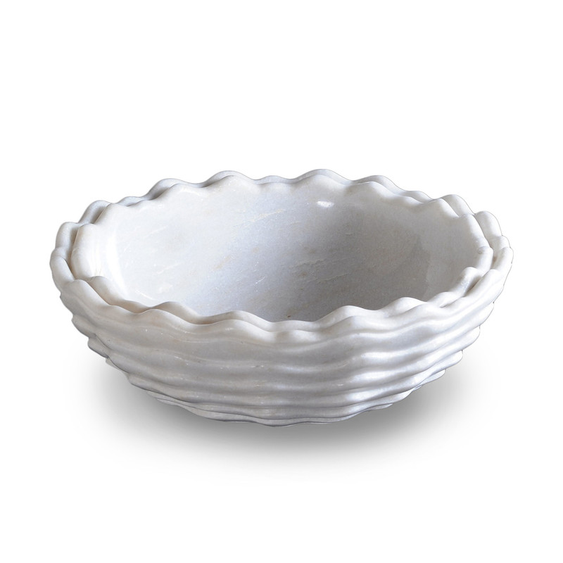 The Oceansong scallop-shaped hand basin is carved from white marble and makes a lovely addition to any bathroom.