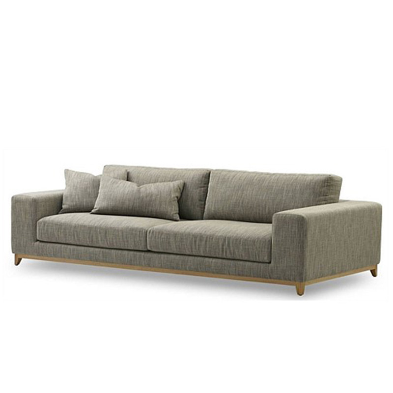 The Aston 3 seater leather sofa features a relaxed contemporary design, with feather top seat cushions and wide arm rests for extra comfort. Fabric. 3/4 view