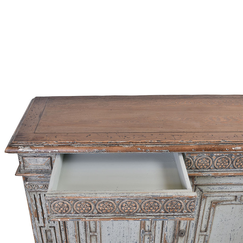 This exquisite sideboard has been reclaimed using materials from 150 year old Chinese buildings. Beautifully distressed in a grey wash finish featuring ornate carvings. This unique piece will be a highlight any room! Draws open