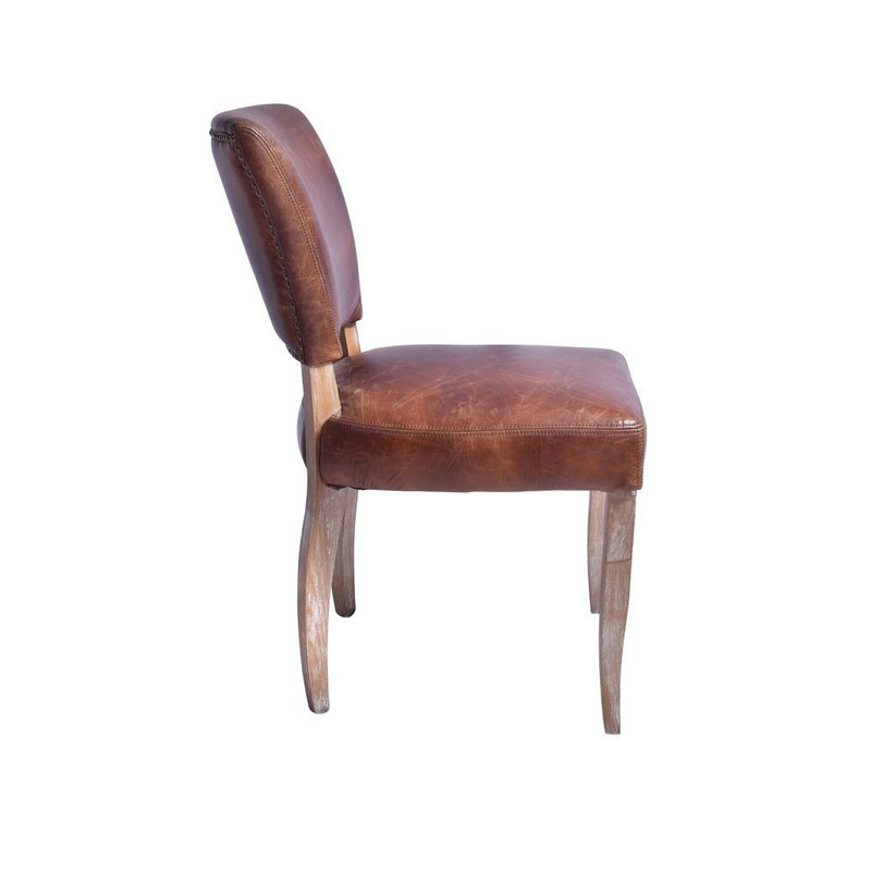 Our Detroit Vintage Chair is upholstered in a waxed aged leather with gold stud detailing around the back of the chair. It embraces a classic style with old age charm & comfort. Will look seamless around any dining table or as a sophisticated office chair. Side view