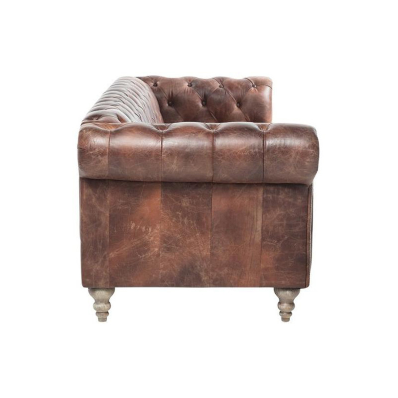 The Eastside leather Chesterfield 4 seater sofa is inspired by iconic British design, for timeless style. Upholstered in distressed leather, featuring diamond buttoning, brass stud detailing, high rolled arms and turned timber legs. Side