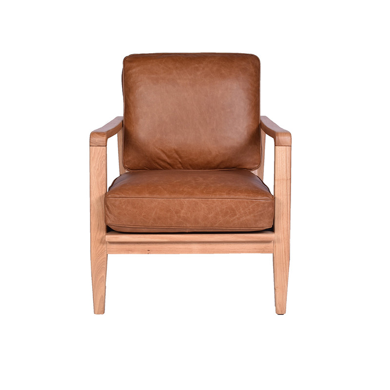 The Four Buckle Armchair is upholstered in soft aged Colombian leather. With the classic four buckle leather strap design, showcased in a finely crafted timber frame. front