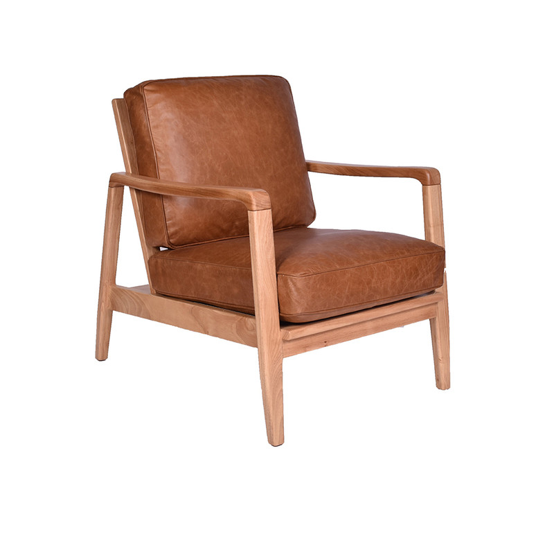 The Four Buckle Armchair is upholstered in soft aged Colombian leather. With the classic four buckle leather strap design, showcased in a finely crafted timber frame. 3/4