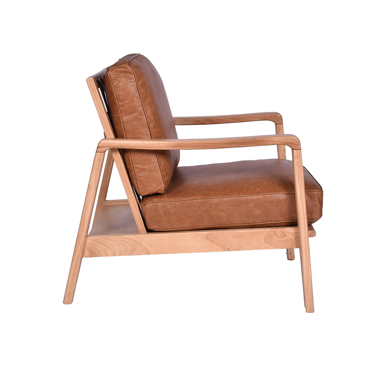 The Four Buckle Armchair is upholstered in soft aged Colombian leather. With the classic four buckle leather strap design, showcased in a finely crafted timber frame. side
