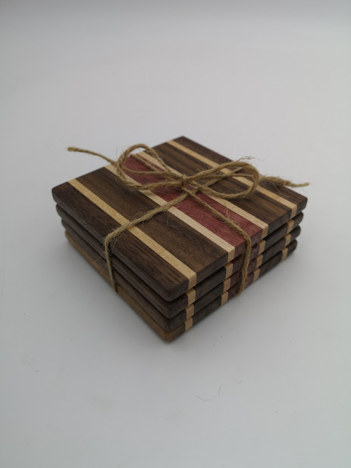 Walnut, maple, and purple heart coaster set