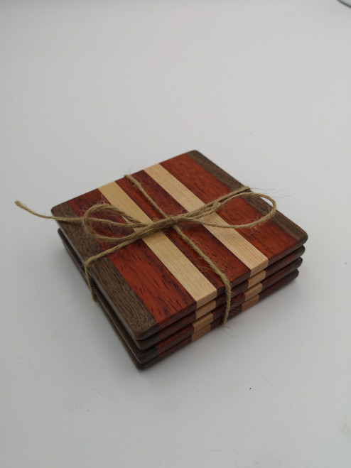 Walnut, maple, and padauk coaster set