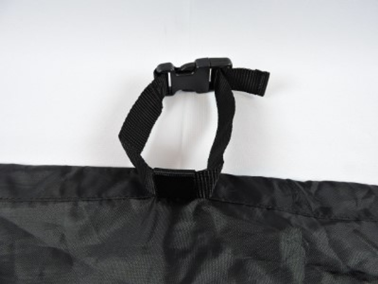 Advantage loop with strap and buckle for secure tie down