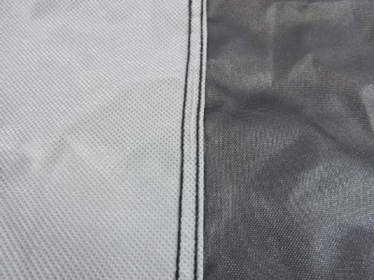 Nanook water resistant inner coating and soft non-woven liner to protect cowl and windscreen