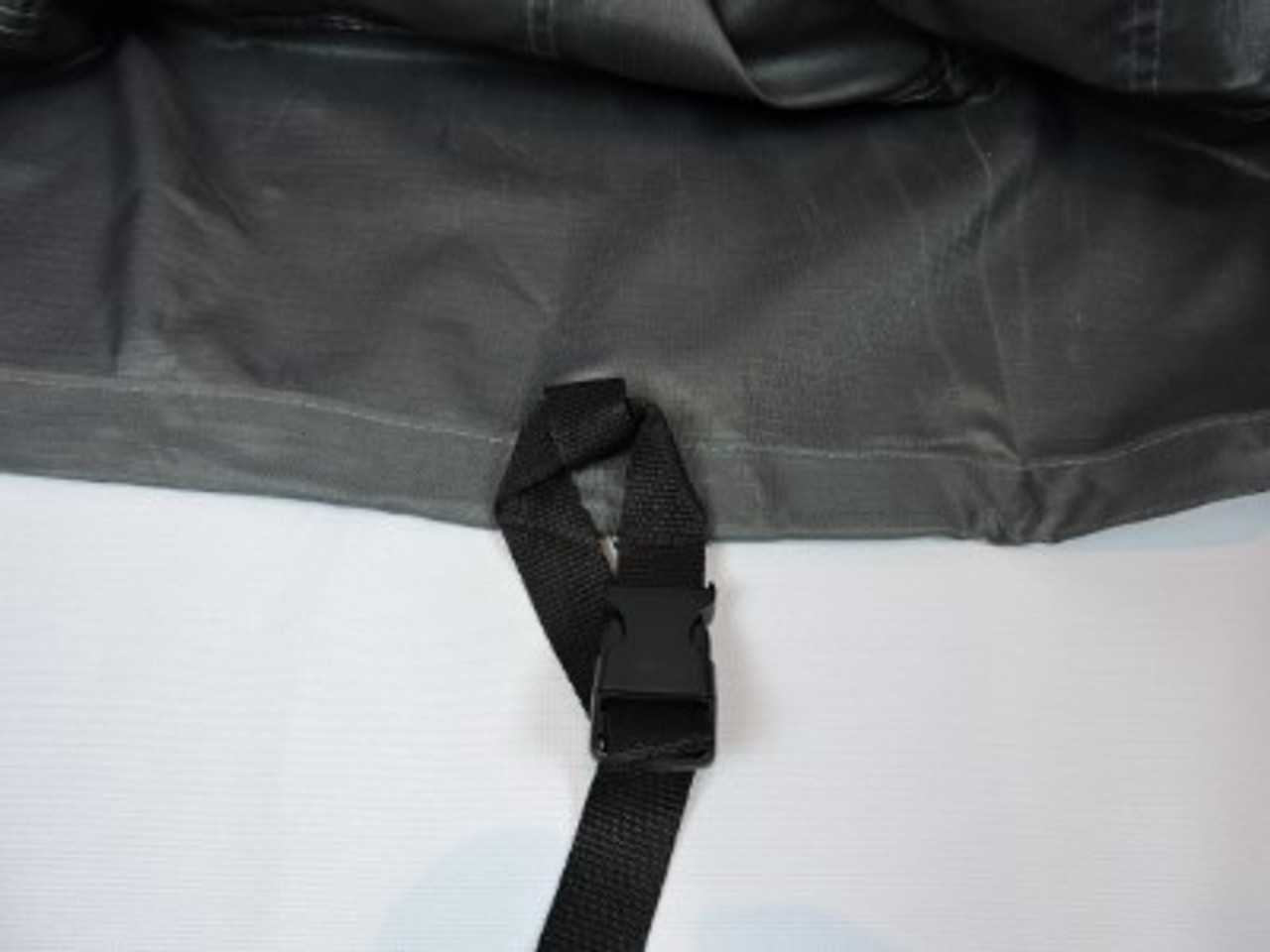 Avalon strap and buckle system for secure tie down