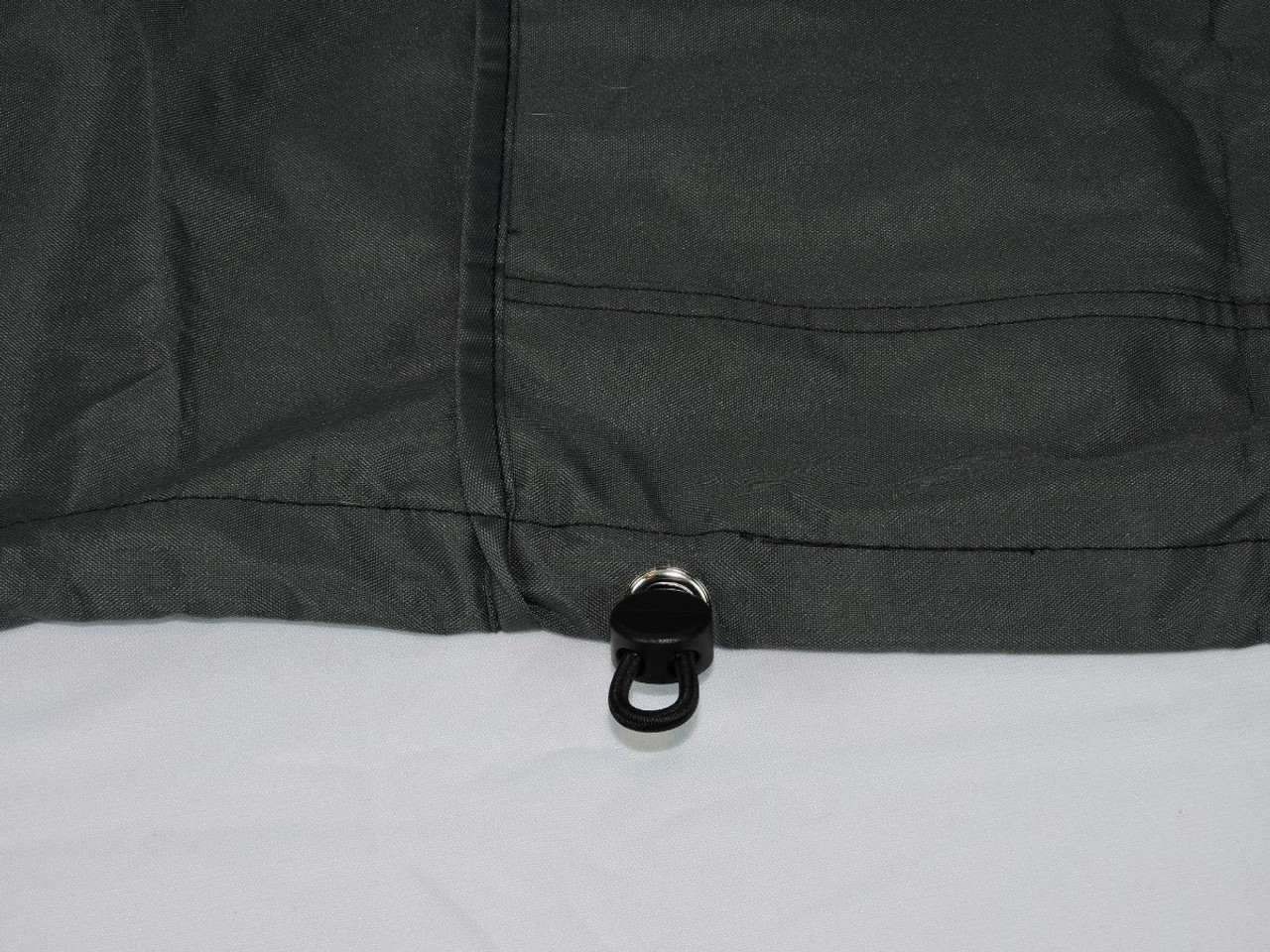 Strong adjustable hem shock cord with lock