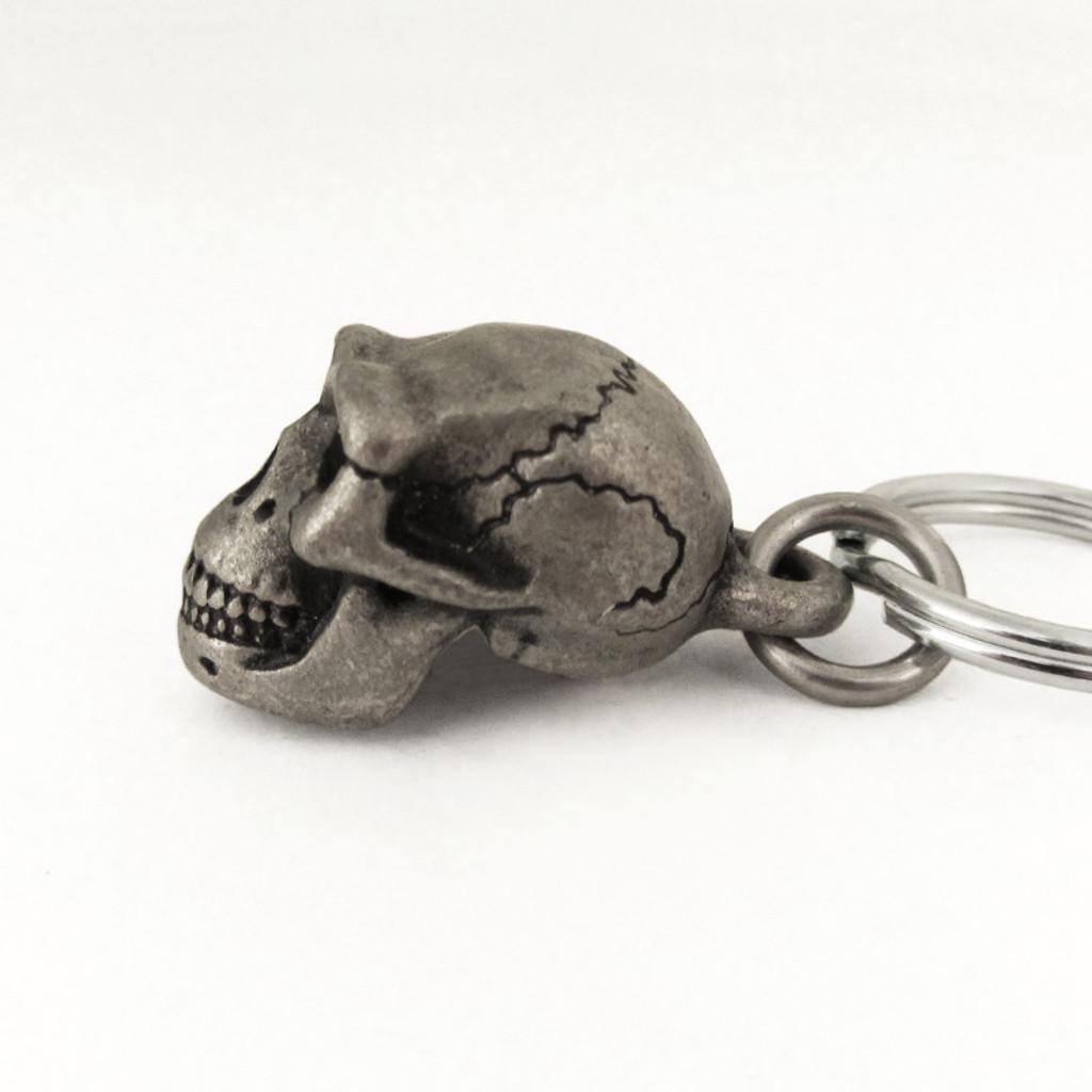 Homo erectus skull keychain