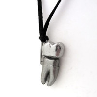 human tooth anatomy locket necklace in partially open position