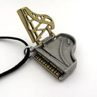 grand piano locket with cast iron plate open
