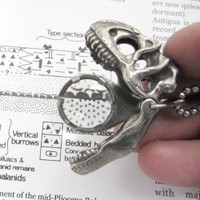 Allosaurus Magnifier Pendant in open position