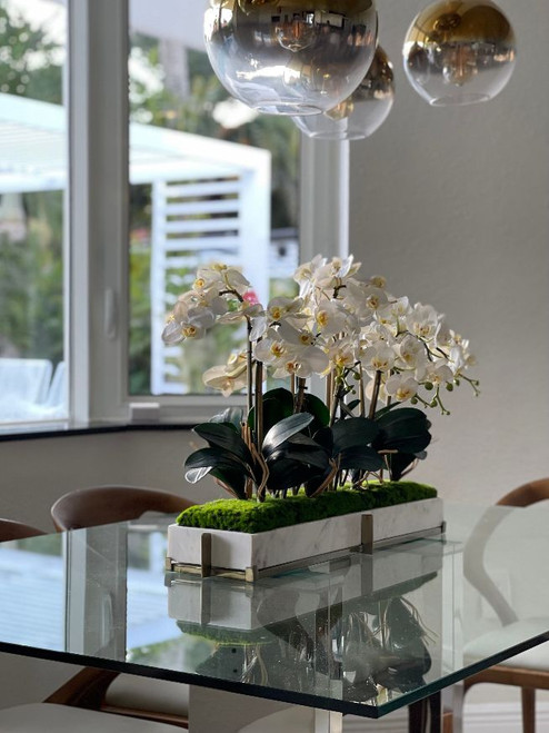 Marble tray on metal stand with mini-phaleanopsis orchid garden