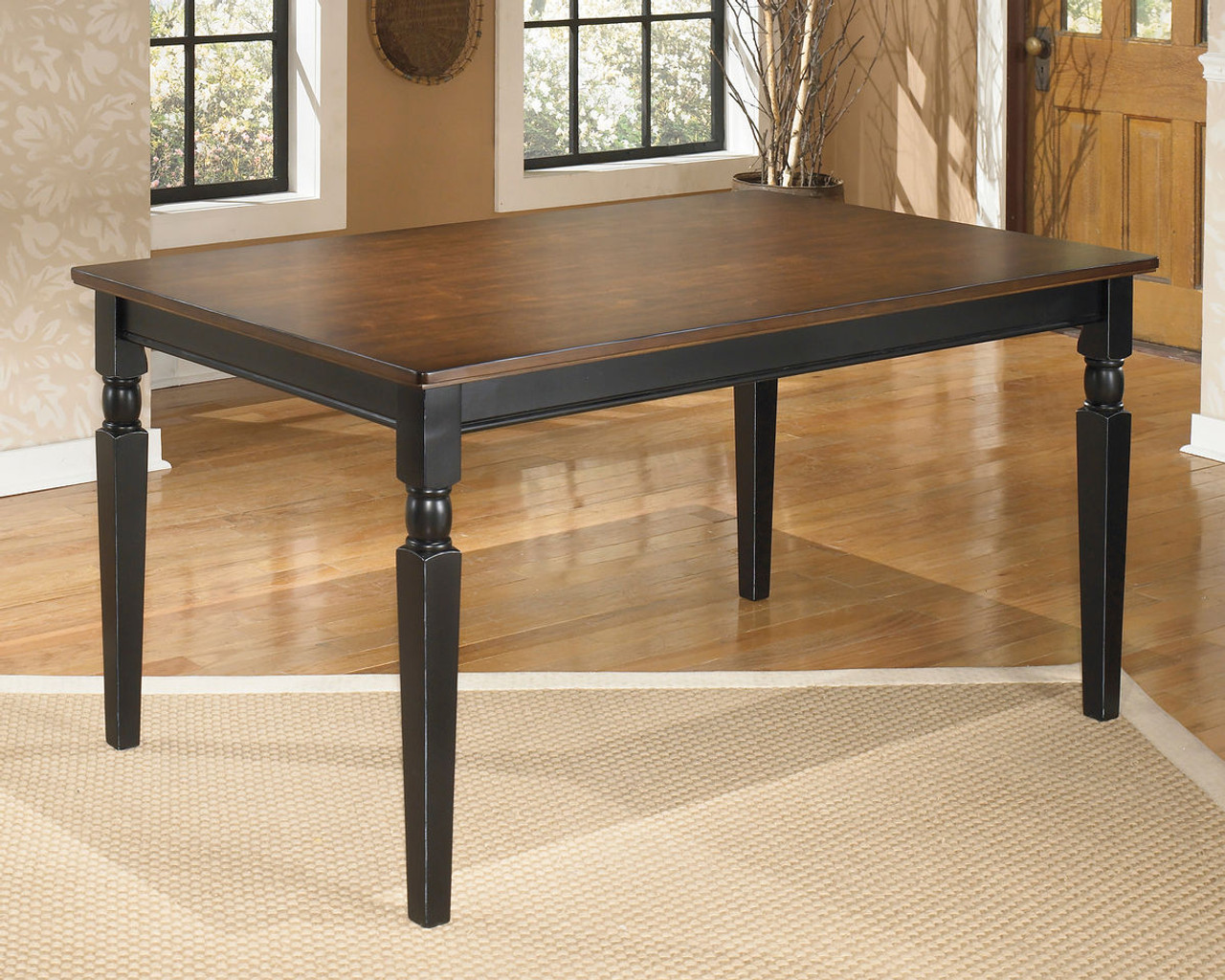 Picture of: The Owingsville Black Brown Rectangular Dining Room Table Available At Home Trends Furniture And Mattress And Jeff S Furniture Serving Rocky Mount Nc