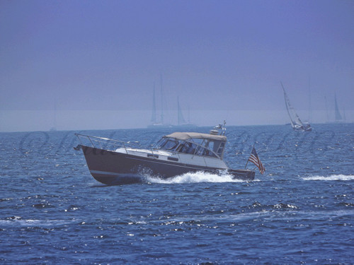 Picnic Boat Among Sail