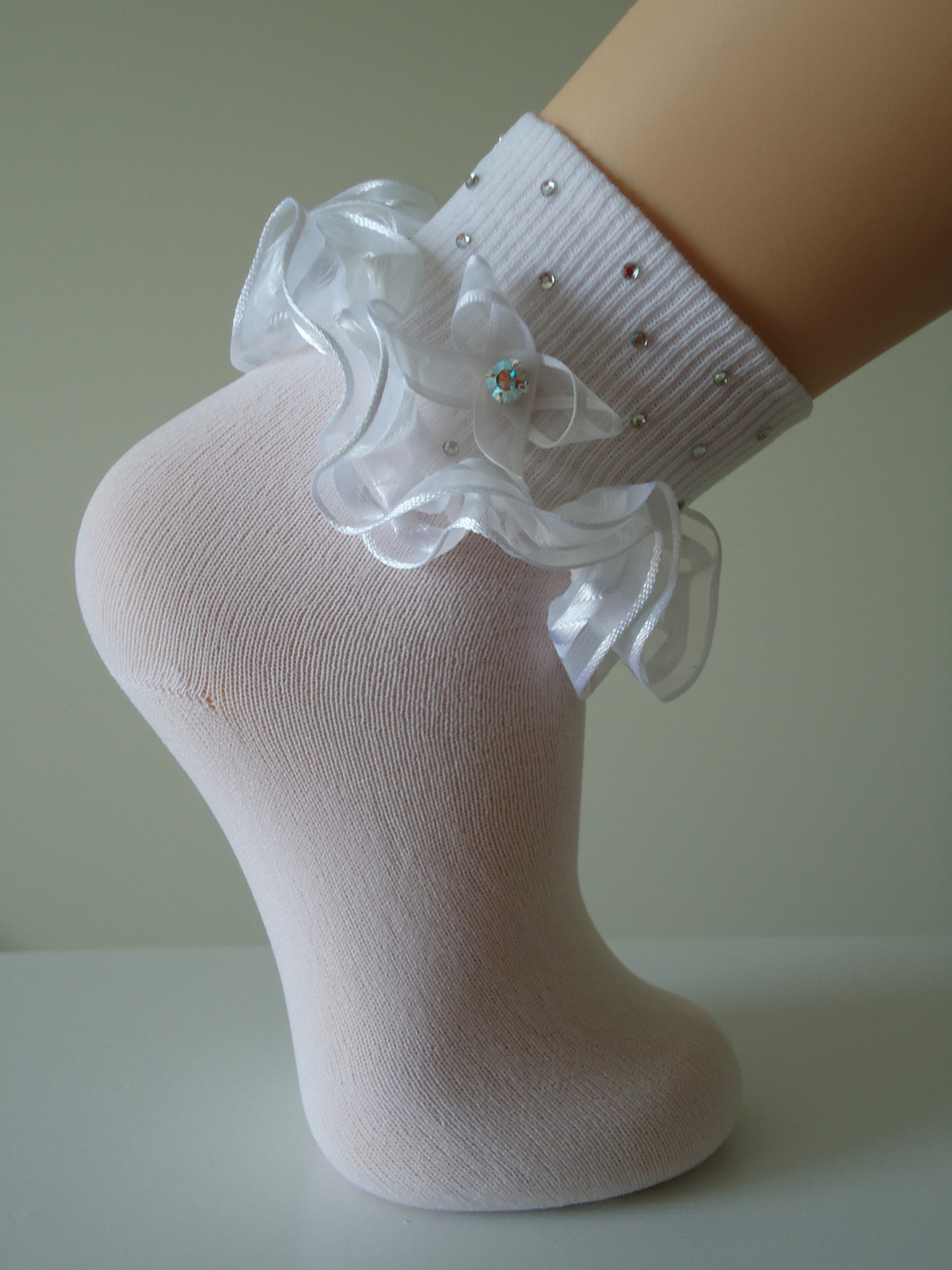 white ruffled pageant socks for little girls embellished with Swarovski stones