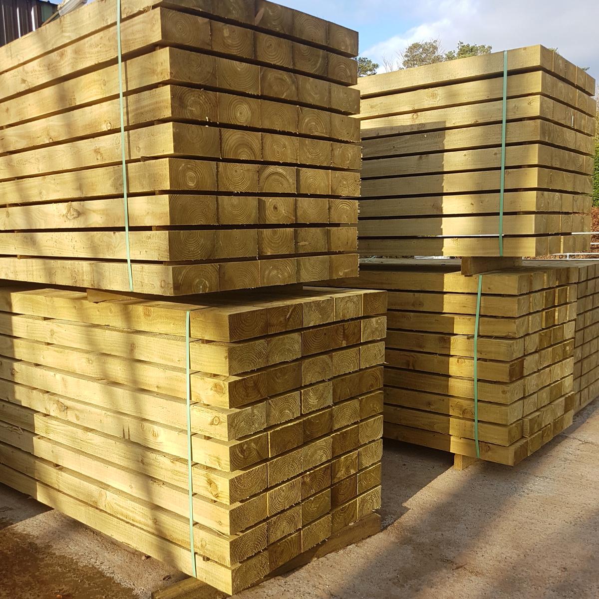 timber railway sleepers stacked mitchell turf