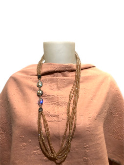 mannequin wearing pink scarf and necklace