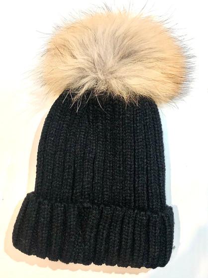 black hat with tan fur pom pom