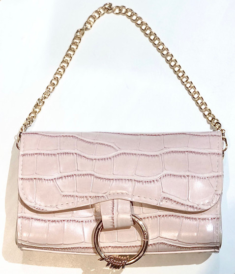 light pink clutch on white background