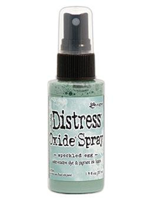 Speckled Egg Distress Oxide Spray ink - Tim Holtz. Tim Holtz Distress® Oxide® Spray is a dye and pigment ink fusion that creates oxidized effects when sprayed with water. Use for quick and easy ink coverage on porous surfaces. Spray through stencils, layer colors, spritz with water and watch the color mix and blend.  2oz bottle