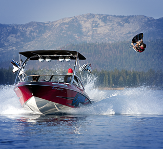 Professional rider using Aerial wakeboard tower at the lake
