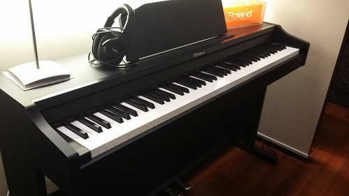 Roland RP102 Flat Black Digital Piano. Exciting sounds and touch. (Headphones sold separately)