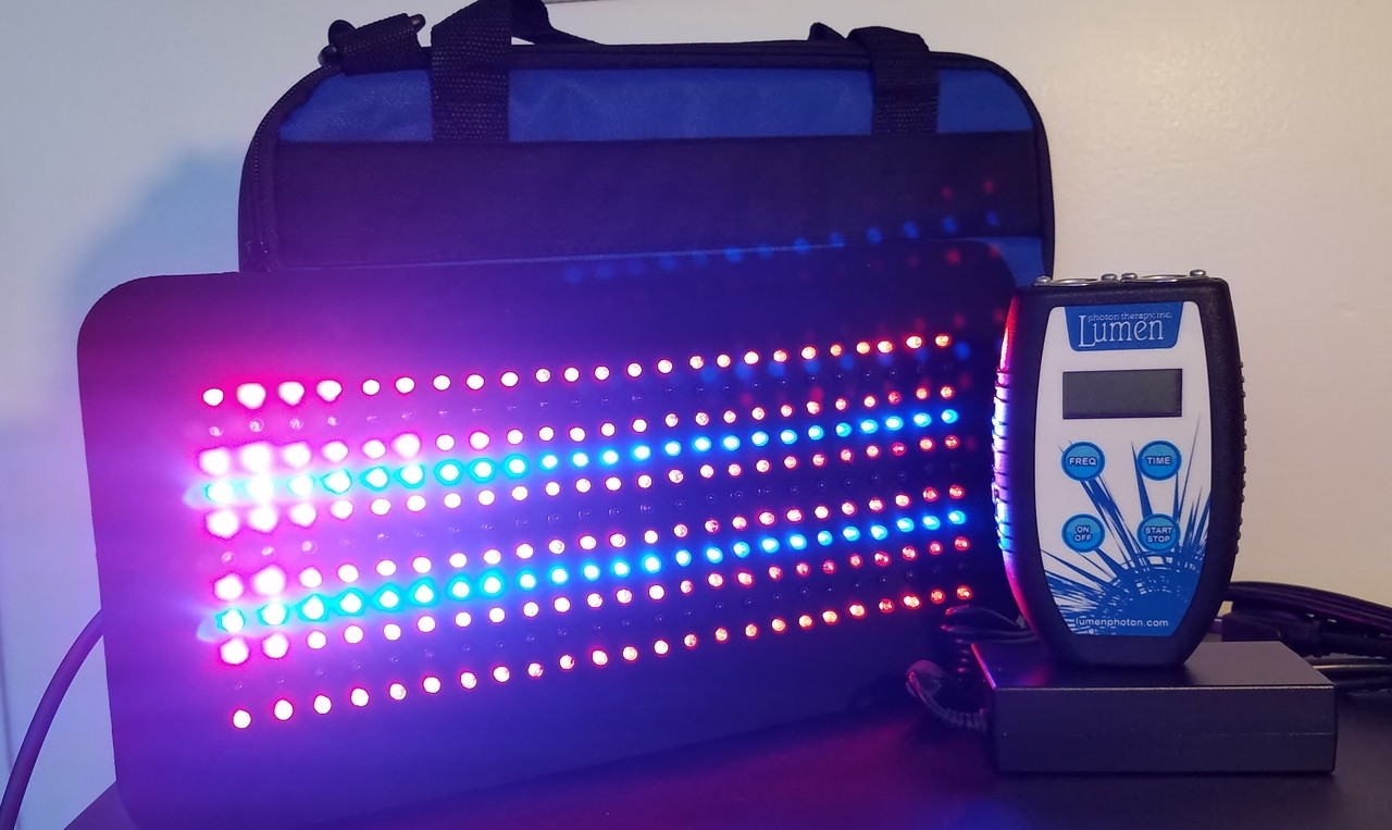 """The Tri-Light 264 is a combination pad with Red, Blue and Infrared LEDs.  The Lumen 264™ pad measures 7 ½"""" wide by 14 ½"""" long, allowing for treatment of large areas such as the back. The Lumen 264™ comes in a padded canvas case."""