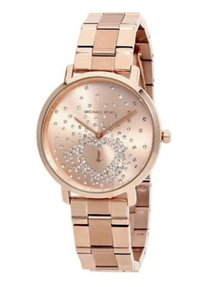 Rose gold tone stainless steel case and bracelet    Round case, 38 mm    Fixed rose gold tone stainless steel bezel    Rose gold tone heart sparkly dial with rose gold tone hands   Quartz movement   Water resistant to 50 meters   Adjustable bracelet   Push button fold over clasp