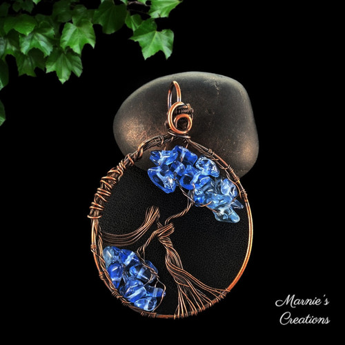 Copper wire pendant with a female figure and blue glass bead chips