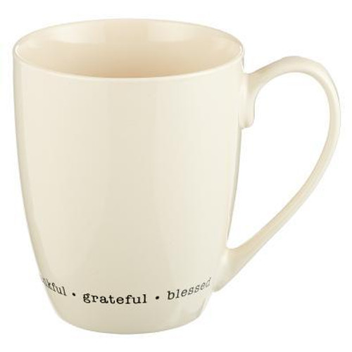 """The ceramic Thankful Grateful Blessed Mug features """"Thankful Grateful Blessed"""" at the base of the mug. Packaged in a gift box, it is dishwasher and microwave safe. Vendor: CAG Published: 10/25/2018 Binding Type: OtherWeight: 0.70lbsSize: 4.50h x 4.50w x 3.50d ISBN: 0843310100202"""
